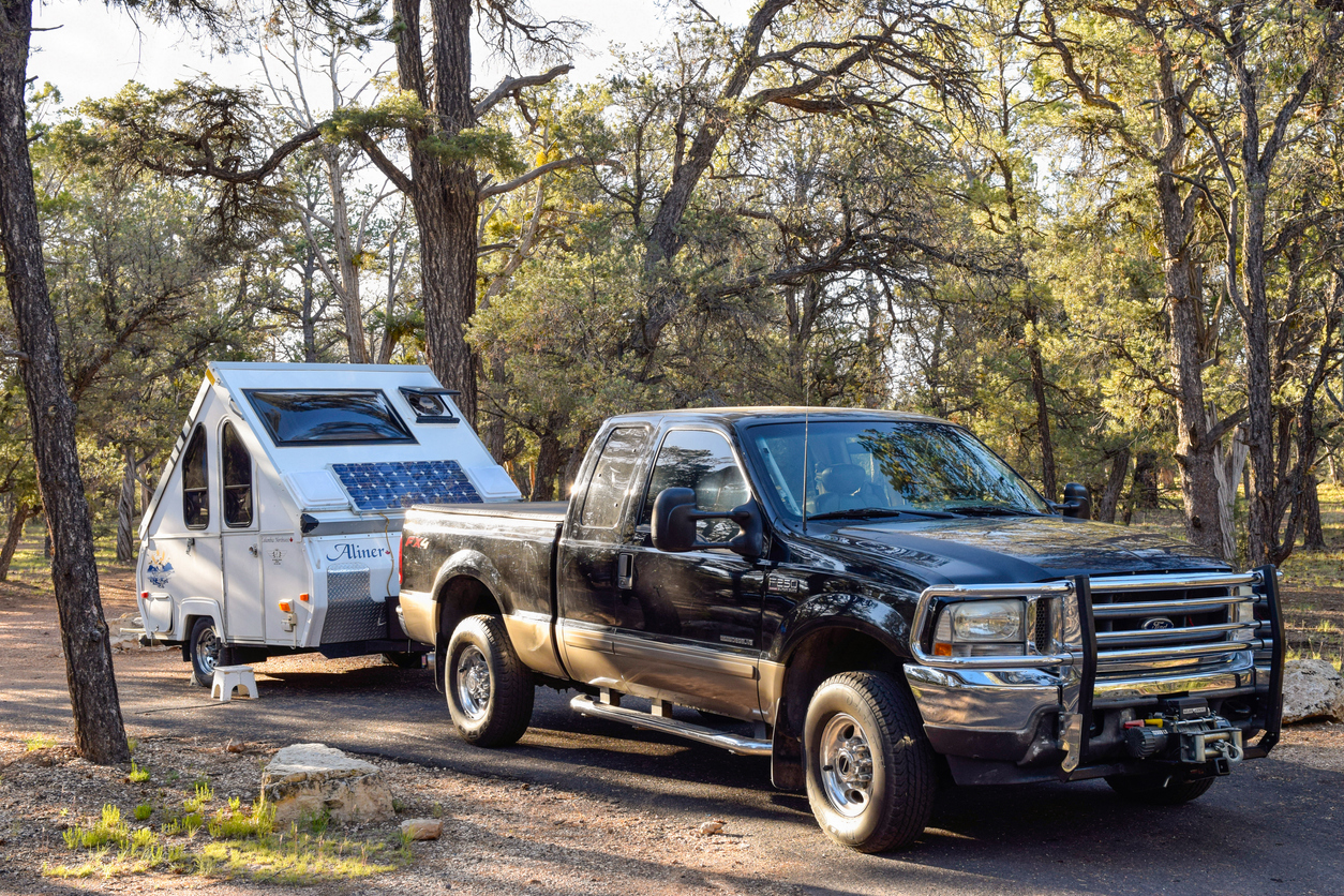 why you should buy a compact camper, truck pulling a-line RV