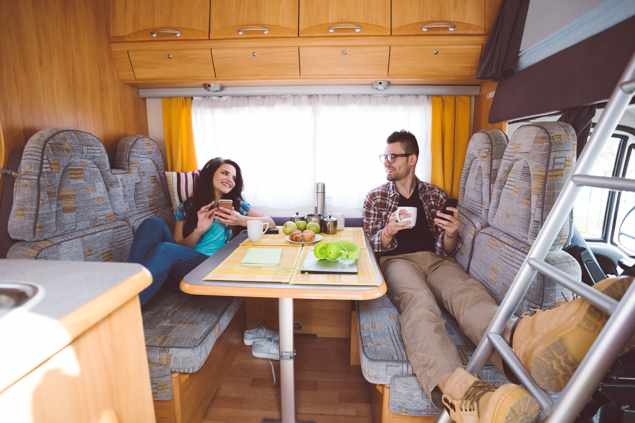 best free apps for RVers - couple drinking coffee in RV