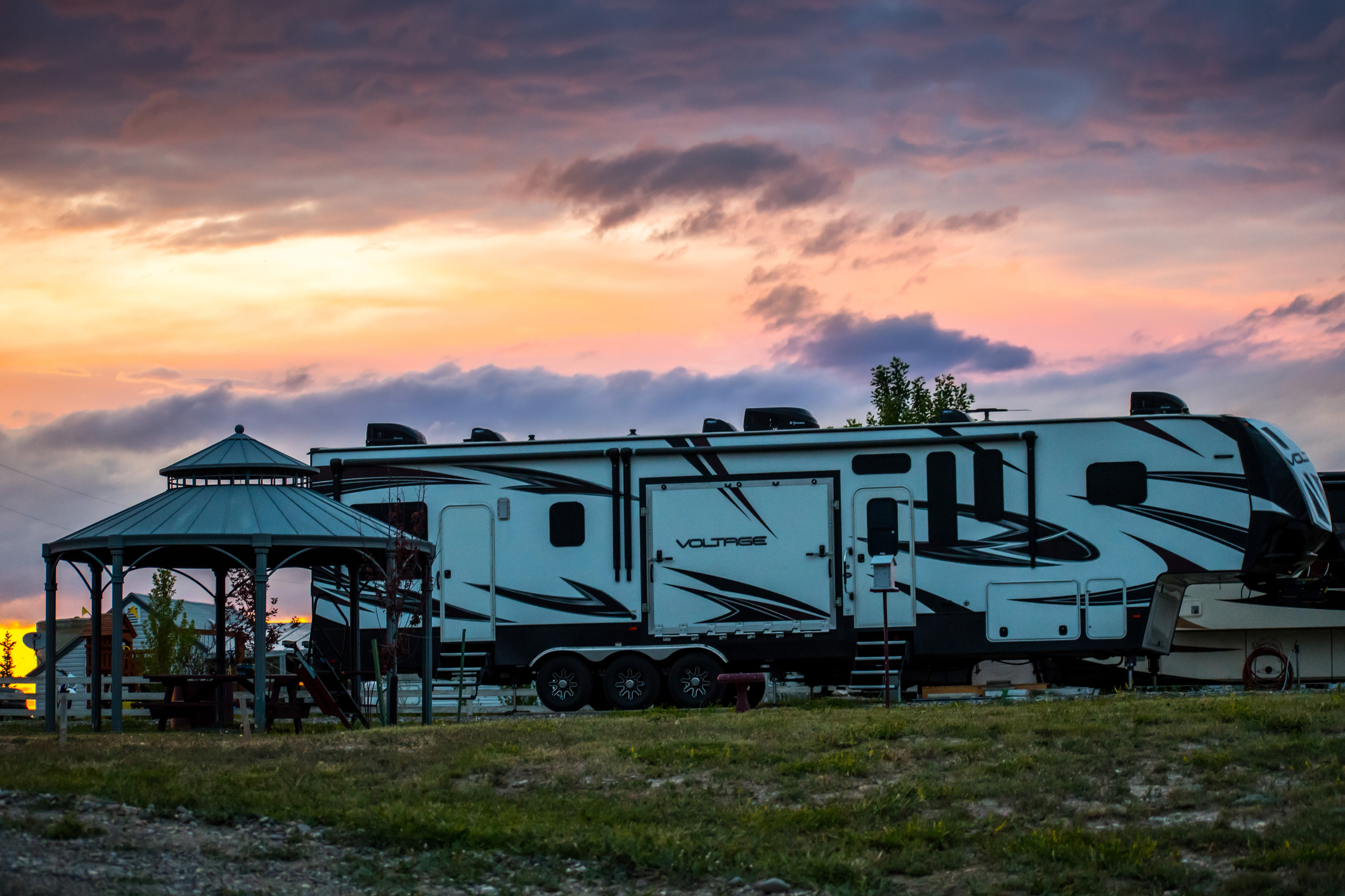 best free apps for RVers travel trailer parked at sunset