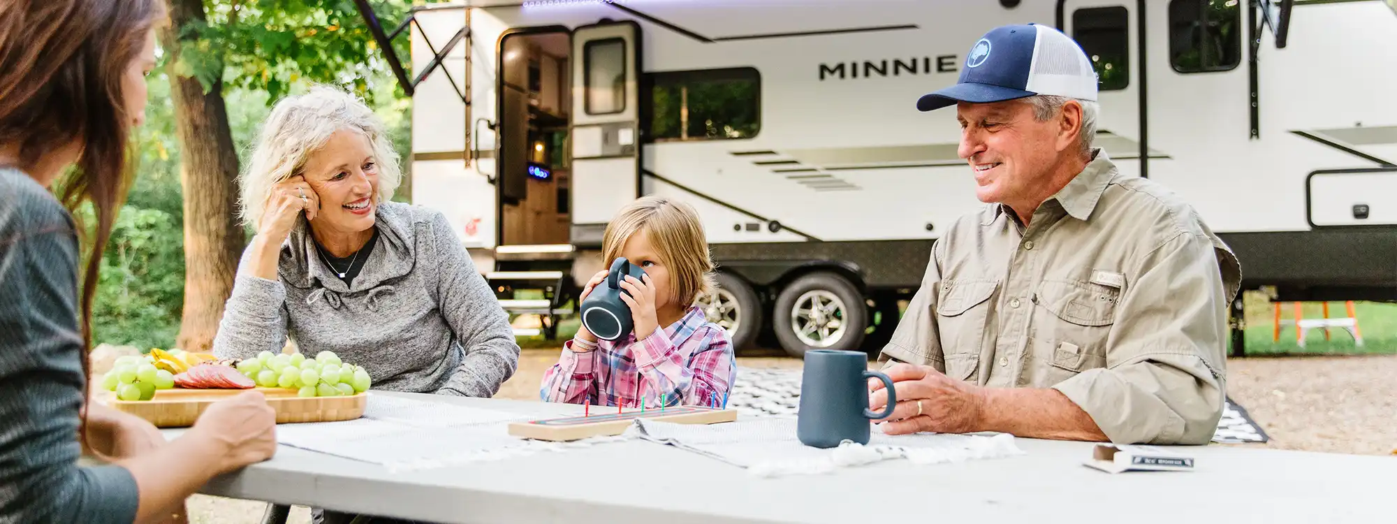 best winnebago campers family eating outside