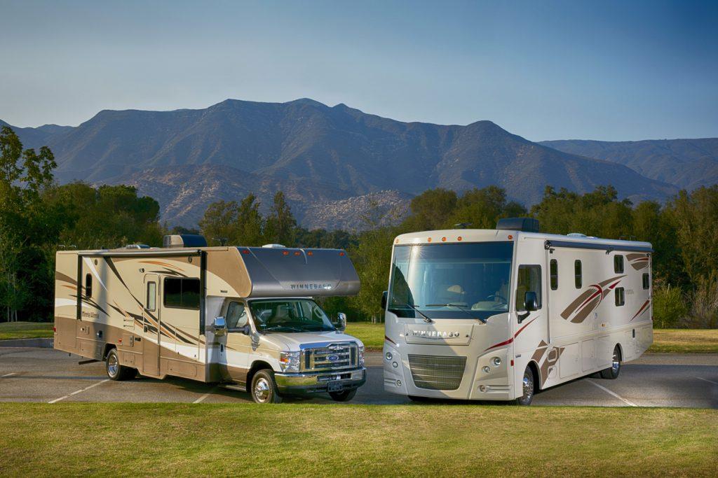 Class C Motorhomes - Ojai, California USA - August 25, 2016: Winnebago Vista and Mini Winnie parked head to head with mountains and blue sky in beautiful Ojai, CA.