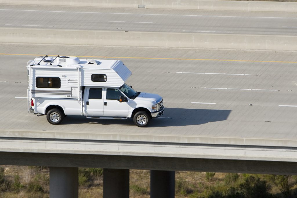 A camper heads down the road on vacation.