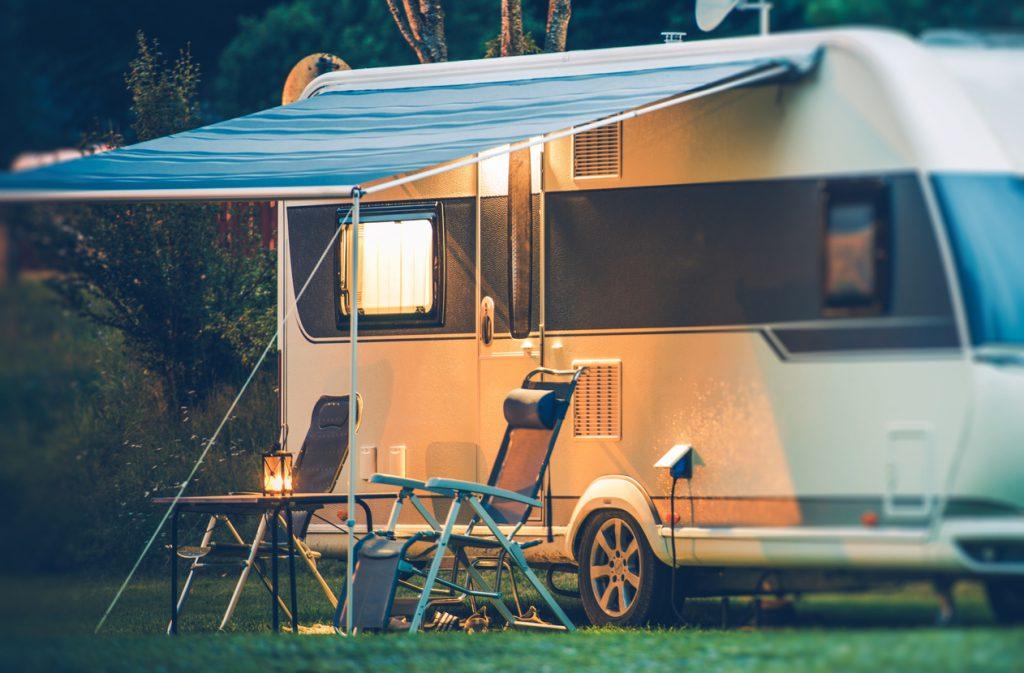 RV Security - Travel Trailer Caravaning. RV Park Camping at Night.
