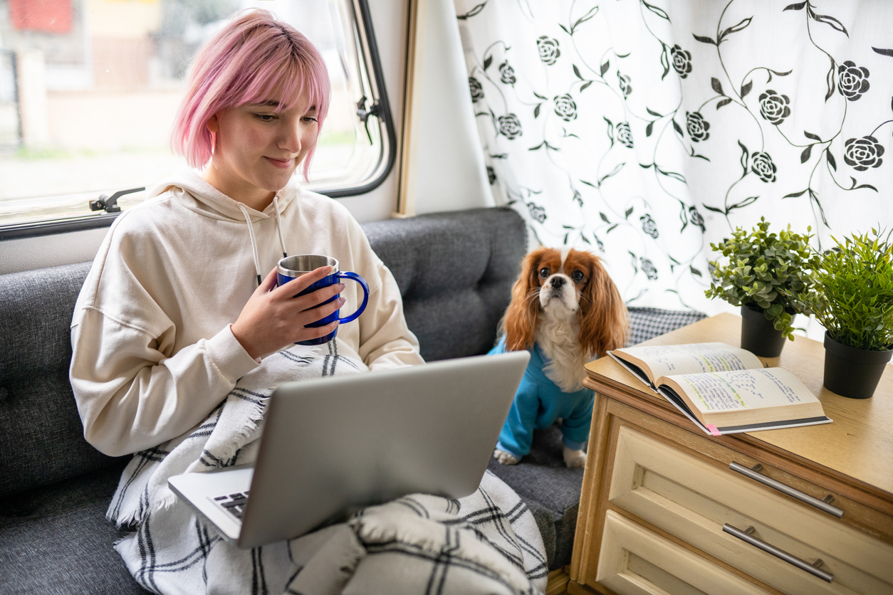 RV wifi - Pink haired young girl attends online class from her caravan