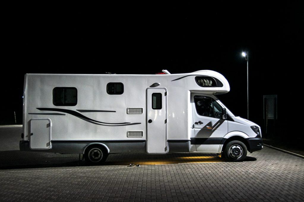 Free overnight RV parking - Night scene caravan parked at parking lot, san Juan province, Argentina