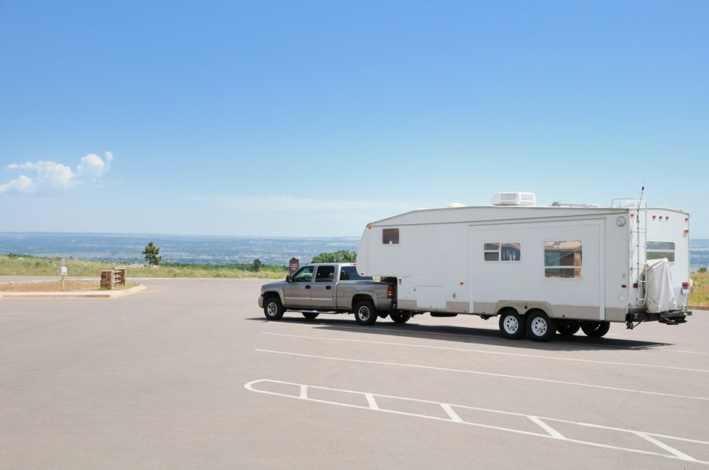 """Free overnight RV parking - """"Trailer in campground on top of mountain overlooking valley, with tow vehicle and copy space"""""""